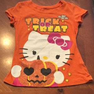 Orange Hello Kitty shirt with sparkly pumpkin 🎃